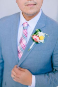 The bright details really make the grooms gray suit pop. | See more of this multicultural real #wedding here: http://www.mywedding.com/articles/jorge-and-amys-fantastic-san-francisco-ca-wedding-by-your-dream-photo/