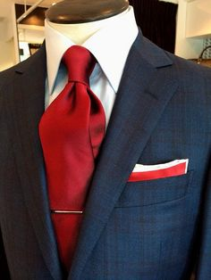 It's hard to go wrong pairing a plaid suit with a solid shirt and tie