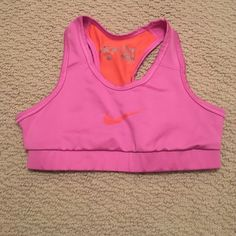 Nike Sports Bra Nike dri fit [Fitted] sports bra. Size medium but fits like a small or XS. This bra is the prettiest colors with Orange mesh in the razor back area. In PERFECT condition!! Nike Intimates & Sleepwear Bras