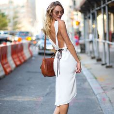New York Fashion Week Spring 2015 Street Style - Candice Swanepoel beating the heat in white.