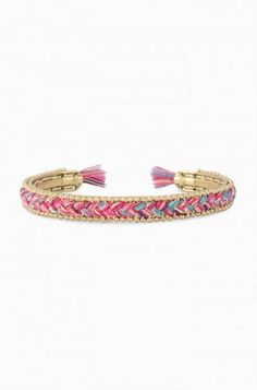 "For your inner wanderer. Hand braided multicolor threads with hints of pinks and blues on a malleable gold cuff.   2 1/4"" inner diameter.  Vintage and shiny gold plating.  Adjusts to fit SM-LG wrists. Copyright © 2014 Stella & Dot LLC."