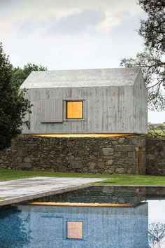 Guest House | Rustic contemporary new concrete and old stone foundation