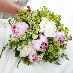 Photo of my wedding bouquet of peonies and local flowers and greenery created by the sustainable farm, Buckeye Blooms. Beautiful and responsible!