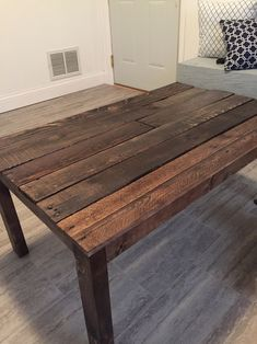 This rustic pallet coffee table has a hidden storage compartment for your remotes!
