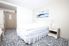Whale Theme rooms at Fosshotel Husavik. How do you like the carpet? #hoteliceland #icelandhotel #northeasticelandhotel #icelandaccommodations #hotelsnortheasticeland #conferencefacilitiesiceland #hotelhusavik #husavikhotels #accommodationhusavik #husavikaccommodation