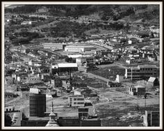 District Six was a multi working-class area just off the centre of Cape Town, to the south of the Castle. Paris Skyline, New York Skyline, Most Beautiful Cities, Old Pictures, Cape Town, South Africa, Places To Go, Castle, Tours