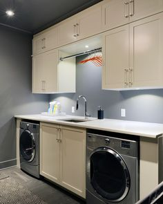 White cabinets and ample storage in this laundry room design | Tanya Collins Design