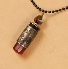 etched bullet pendant - Carnelian - bullet casing jewelry. $29.00, via Etsy.