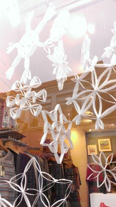 Handmade snowflakes in our Christmas windows at Seasalt