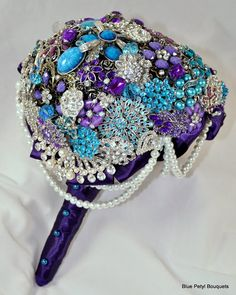 Cascading Brooch Bouquet.  The pearls draped around the base of the bouquet are pretty, @Jodi Wright!
