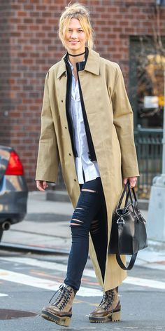 Talk about the perfect winter outfit. Heading out of her N.Y.C. apartment, Karlie Kloss made her trench coat multi-seasonal by layering up over her slim jeans and weather appropriate boots.