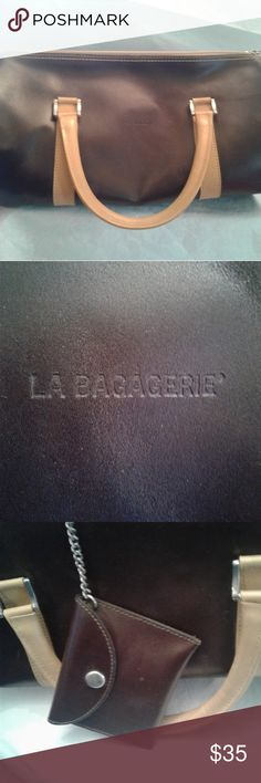 👜La Bagagerie Double Strap Barrel Bag👜 Vintage French 🇫🇷 La Bagagerie Double Strap Barrel Bag. Believe it to be faux leather with a small mark on one end (see pictures).   There is the traditional lock zipper pull with La Bagagerie on it. Inside there is a small coin purse on a stainless steel chain. La Bagagerie Bags Satchels