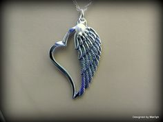 Sterling silver angel wing necklace, heart necklace,  memorial necklace, religious necklace by DesignedByMarilyn on Etsy https://www.etsy.com/listing/206274374/sterling-silver-angel-wing-necklace