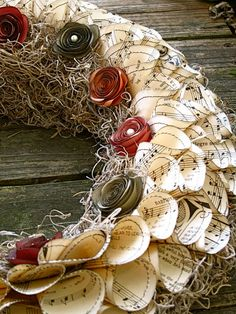 Sheet music wreath - how pretty and whimsical and *me*!  :)