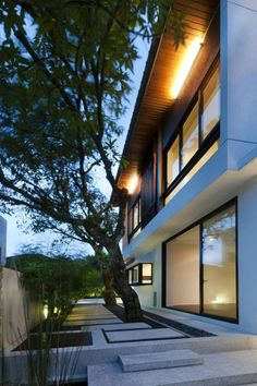 Hijauan House was completed by the Kuala Lumpur based studio Twenty-Nine Design. This two story residence was built with the Malay word 'Hijau' meaning 'green' Kuala Lumpur, Modern Patio Doors, Green House Design, Sliding Door Design, Two Storey House, Terrace Design, Garden Design, Concrete Design, Concrete Tiles