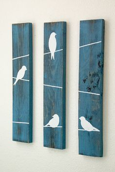 This is the perfect addition to any bedroom, family room, bathroom, baby room, or kitchen! Three piece set made from wood. Each piece is stained, painted, and sanded to allow for a rustic look. Birds on a wire are hand painted with love! This set would match perfectly with its larger, sister set located in my shop! Dimensions of each board are 18in x 3.5in. Boards are not attached to one another to allow for customization of position/layout in your home. Each board has hooks already ...