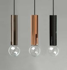 Designed as part of AfroditiKrassa's first product range, the AKollection. The Pentagon Pendant light comprises five flat rectangular panels of bevelled, tinted,mirrored glass around the light bulb casing.  The glass panels, available in a choice of three colours – bronze, rosé and black – are made by a specialist glass workshop in the UK. Aluminium bulb casing, an LED bulb and cabling complete the lights.