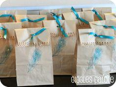 princess peacock birthday party goodie bags. Great way to jazz up plain paper bags.