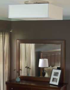 Tech Lighting's Chambers is a square shaped, fabric flush mount.  Its glass diffuser emits a glare-free wash of light.  This fixture's simplicity and neutral colors complement any living room, entryway, dining room, or open space style.   It is available in desert clay and white color options.  A satin nickel finish is available with incandescent lighting, compact fluorescent lighting, and LED lamping options. www.luxurylightingdirect.com
