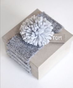 cozy winter giftwrap with a pompom