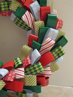 Paper Wreath...or it would be cool with ribbon too!