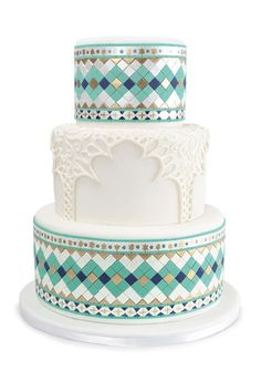 lovely cake ... tiles of blue fondant form lovely pattern with hearts top and bottom ... lacey archways grace the middle layer ...