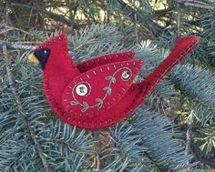 This Cardinal ornament is three dimensional and can be displayed from both sides. Approximate size is 3 tall x 5 1/2 long x 1 1/2 wide. Made from 100% dark red wool felt (color may appear bright red on some computer screens). All stitching and embroidery work on this cardinal