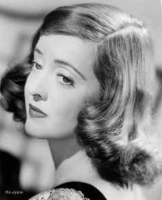 Bette Davis // Hair: red - Eyes: blue - Height: 160 cm - Background: English - Nationality: American