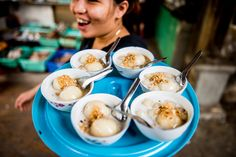 """Have you ever tried """"a dumpling drifting in water"""" on the streets of Hanoi? Although it may sound intimidating, like one of those dishes featured on Anthony Bourdain's epic food shows, this simple, yet delectable dessert is known amongst the streets as chè trôi nước (aka bánh trôi nước)."""