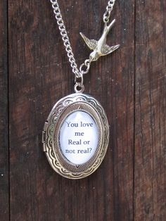 Silver Hunger Games locket necklace by FairytaleMadness on Etsy, $18.00