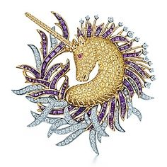 GOLDEN UNICORN BROOCH ~ White and yellow gold with diamonds and amethyst and a Ruby eye. Tiffany & Co.