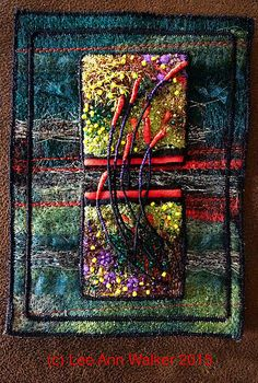 "Lee Ann Walker- 28-2"" Fireflies. 7/28/2015. Machine felted and embroidered, poly sheers, metallics on commercial felt, wire thread and beads. Playing with mounting 2"" squares on larger base to frame. 