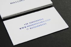 Blue foiled business cards with rough edge detail designed by Think Work Observe for Massimo Cabai.