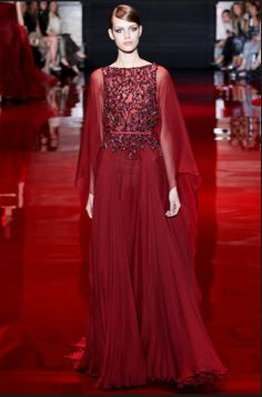 11. Ellie Saab, Fall 2013; Doric Chiton Inspired- fastened at both shoulders, high wasted with pleated skirt.