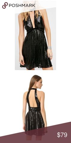 Free People Black Sequin Dress Size 4 NWT, gorgeous free people dress! retail $98. the perfect little black dress. unique cut and open back! hangs beautifully Free People Dresses Mini