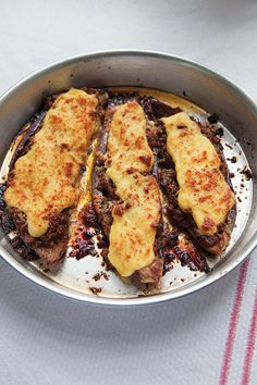Papoutsakia: a Greek dish of eggplant stuffed with ground beef and topped with a savory bechamel.