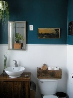 Bathroom: petrol (walls) - wood (furniture and doors) - white (wall tiles, porcelain) -