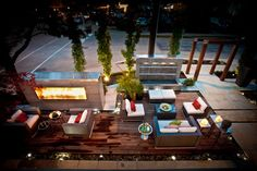 The deck is made of ipe and contains several different spaces for relaxing out front. Two tall concrete structures provide privacy from the street — one features fire; the other, water. The fountain is 6 feet wide and 6 feet high; the fireplace is 8 feet wide and 6 feet high.