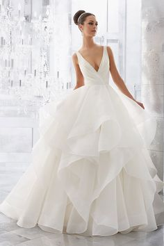Wedding Dress out of Morilee by Madeline Gardner Style 5577 Light and Airy, this Stunning Flounced Organza Ball Gown with Horsehair Edging Features a Plunging V-Neck and Open V-Back. Illusion Insets Along Sides. Colors Available: White, Ivory. Mori Lee Wedding Dress, Wedding Dress Types, Wedding Dress Pictures, Wedding Dress Train, Luxury Wedding Dress, Long Wedding Dresses, Wedding Dress Shopping, Designer Wedding Dresses, Bridal Dresses