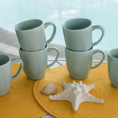 The RYO Mug Set is a great addition to any dinner table. Bring your friends and family together with this Porcelain set that contains six 14.20 ounce Mugs. The uniquely designed dinnerware is perfect for formal or casual dining. Color variations include: Santorini, Art, Pink Sand, Blue Bay, Bambu, and White.