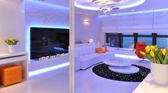blaues led licht weißes interieur design orange akzente