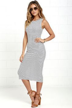 The Olive & Oak Baylee Ivory and Navy Blue Striped Midi Dress will be your new go-to! Stretchy rayon knit shapes this casual, figure-hugging midi dress with tank straps, and a rounded neckline.