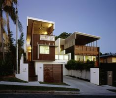 Vertical aluminum louvers help maintain privacy for this home.