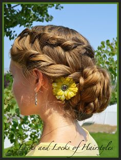 I think it's a waterfall twist, and then a french twist  into a braided bun. It's pretty!