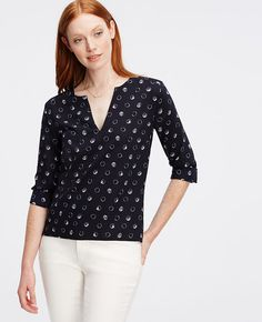 Clean, tailored and sophisticated, our split neck popover is the perfect canvas to showcase the season's polished prints. Split neck. Long sleeves with button closure. Elliptical hem.