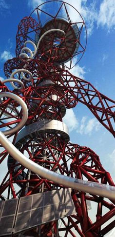 See the world's longest and tallest slide as work begins in London - Work has begun on the world's longest and tallest tunnel slide around the Orbit tower at The Olympic Park in London. Specialist abseilers have been lifting the first parts of the 178-METRE long slide into place today ready for it to open to visitors early this summer. 13th April 2016