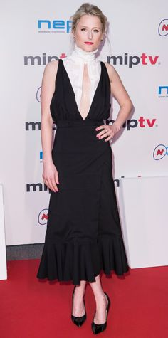 Mamie Gummer struck a pose at the MIP TV Opening Night Gala in Cannes in a plunging cut-out high-neck top with a midi-length, high-slit skirt with a flouncy hem, both by Altuzarra, and patent black pumps.