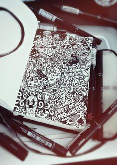 Illusion: Whether he uses black marker only or colored pens, illustrator Lei Melendres does a wonderful job at drawing all over his sketchbook pages.     (Photo © Lei Melendres)    http://illusion.scene360.com/art/33546/crazy-comix-doodles/