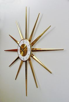 Midcentury Modern Clock Starburst Clock, Sunburst Design Atomic Wall Clock, Brass-tone Rays, Sunburst Design Modern Clock, Mad Men. $150.00, via Etsy.