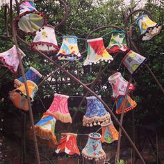 3 x Strings of mini lampshades, each one different, covered in vintage fabrics and trims.